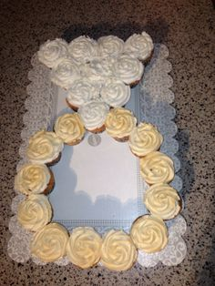 Diamond Ring pull apart cupcake cake.  What I did was Frosted them with buttercream then sprayed the ring with Wilton's Gold color mist shimmering food color spray... It is quick and gives it a elegant touch!