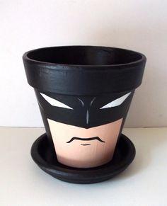 Terra cotta pot painted like batman