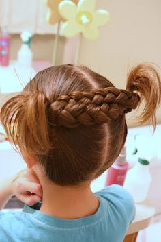 This site has tons of cute ideas for girls hair!  Love these braids :)