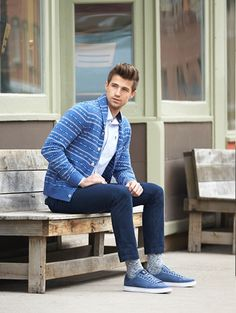 Reach for a white and blue fair isle shawl cardigan and navy jeans for an easy to wear, everyday look. To break out of the mold a little, rock a pair of blue low top sneakers.  Shop this look for $79:  http://lookastic.com/men/looks/longsleeve-shirt-and-socks-and-low-top-sneakers-and-shawl-cardigan-and-jeans/4004  — White Longsleeve Shirt  — Grey Socks  — Blue Low Top Sneakers  — White and Blue Fair Isle Shawl Cardigan  — Navy Jeans