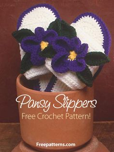 Free Pansy Slippers Crochet Pattern Download from Freepatterns.com -- Lovely floral slippers are worked in medium (worsted) weight yarn. Sizes given for small, medium and large.