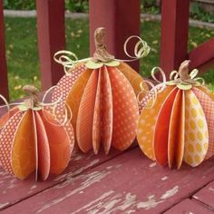 Paper crafting with scrapbook paper.  Fall decorations.    http://paper.tipjunkie.com/pumpkin-table-centerpieces-table-decorations/