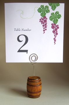 Grape and Vine Table Sign. This design is deal for the modern bride interested in a contemporary look for their wine themed or vineyard #wedding reception.  http://www.winecountryoccasions.com/Grape-and-Vine-Table-Signs-p/sign335.htm.  It looks great with our Barrel Photo and Place Card Holder: http://www.winecountryoccasions.com/Barrel-Photo-Place-Card-Holder-set-of-2-p/ep11028.htm - Wine Country Occasions, www.winecountryoccasions.com