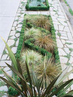 This relatively simple sidewalk garden makes a big statement in a small space: http://www.bhg.com/gardening/landscaping-projects/landscape-basics/sidewalk-garden-front-yard/?socsrc=bhgpin032014makeastatementpage=9
