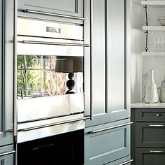 "Kitchen: The Details | Today's appliances are so well designed that the double oven was left in plain view. Architect Ken Pursley says ""There is beauty in the functionality."""