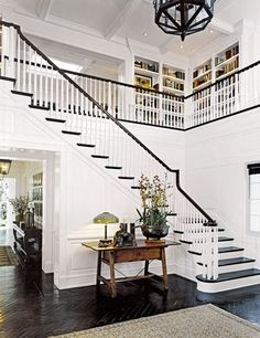 The double-height entrance hall of a home Sandy Gallin owned in Malibu, California.