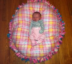 No sew floor pillow. Made just like the no sew blankets just in a circle and stuffed with polyfil :)