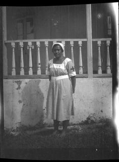 Portrait of nurse in front of building. Creator/Contributor: Lambert, Sylvester Maxwell, 1882-1947, Photographer Date:between 1919 and 1939 Contributing Institution: UC San Diego, Mandeville Special Collections Library