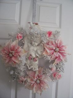 Shabby Christmas Poinsettia Rose Wreath-These are the absolutely fabulous Poinsettia that Michael's had this year.  Hopefully they will return next year as they sold completely out before Thanksgiving.  I am so in love with these. rose wreath, shabbi christma, pink christma, pastel christma, christma poinsettia