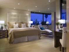 Love the headboard and the windows...chic!