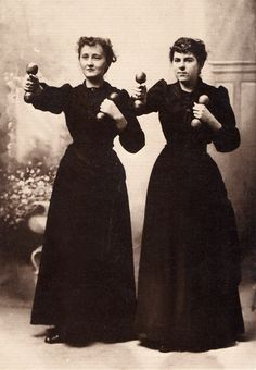 When women first began to work out with weights, it was considered dangerous to have them lift anything heavy and so they were given only two- or four-pound wooden dumbbells. The fact that women lifted much heavier objects in the home seems to have escaped most of the men who designed the exercise. here two cheerful ladies work out in their street clothes in a photograph c. 1910 by Willis T. White. sophiette ladies-who-lift