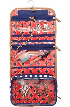 Toiletry travel bag with gorgeous medallion print interior and navy stripe exterior. #stelladot
