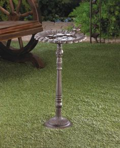 """Cast Iron Hummingbird Bath FREE SHIPPING Now Only $48.89 Make a splash in your yard with classic style! This pretty cast iron birdbath features a sunflower basin and a delightful hummingbird accent.The birds will flock to this gorgeous birdbath! Set it in your garden and watch as they stop by for a refreshing dip in the finely detailed basin. The pedestal base features lovely carved details. 12"""" x 11½"""" x 22½"""" high. Cast Iron.UPC: 849179015725. Some Assembly Required"""