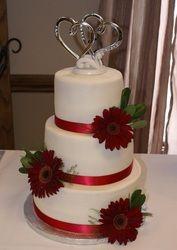 Red gerber daisy wedding cake