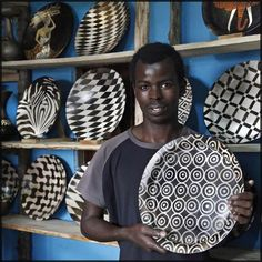 Frederick with his work. All pieces are fired in a simple clay kiln.