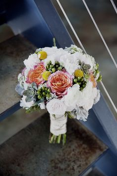 bouquet filled with a mix of various blooms, photo by Mandilynn Photography http://ruffledblog.com/levyland-estate-wedding #weddingbouquet #flowers