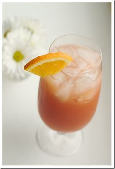 Source: Ammie of Adventures in my kitchen Preparation time: 5 min  INGREDIENTS  2 quarts cranberry juice 1 can pineapple juice (46 ounces) 2 cups orange juice 2 liters ginger ale 1 orange, sliced INSTRUCTIONS  Add all ingredients except orange slices to a large punch bowl with ice. Stir to combine. Float orange slices in punch for garnish.