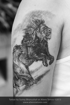 Lion tattoo, Inked by Sunny Bhanushali at Aliens Tattoo, Mumbai. Client travelled all the way from Delhi just to get a tattoo from us. He was looking for a realistic lion for his upper arm, we did a little research on Google and found the amazing image on www.500px.com. Client was very happy with the output of this tattoo, hope you all liked it as well. www.alienstattoos.com