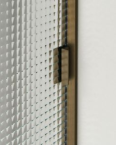 A detail of SHERAZADE door with patterned glass panel. SHERAZADE is the new door collection designed by Piero Lissoni, featuring great elegance and attention to details. door panels are are available in a wide range of finishes. ..... Infos at www.glasitalia.com