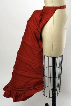 Bright red bustle ca. the 1870s via The Costume Institute of The Metropolitan Museum of Art