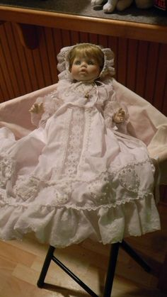 "Susan Wakeen & The Danbury Mint Porcelain ""Christening Day"" Doll.  She comes in her original box, With papers and info, along with wrist tag, She is beautiful. And she has her own lace, silk and pearls heart shaped pillow"