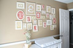 alphabet wall art pink and beige nursery frames of letters on scrapbook paper. white frame wall collage