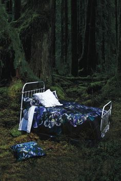 Love an iron bed. Also, can I sleep in the mossy woods too!?