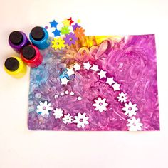 Use foam stickers and finger paint to mix together this colorful and fun artwork that also encourages color recognition skills and fine motor development. Source: LilSugar