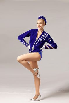 """The """"Velvet March"""" is a patriotic look designed by Deborah Newhall and was introduced by the Rockettes in 1999. This look has been worn at various milestone events. #rockettes #NYC #costumes #dancers #glamorous #white #blue #sailor #patriotic #stars #stripes #velvet #hat #silver"""