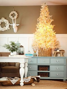 How pretty is this all white Christmas tree? See more ideas: http://www.bhg.com/christmas/trees/christmas-tree-pictures/#page=11
