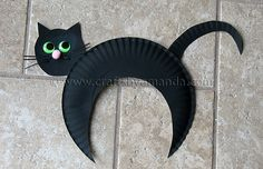 Your students can help you decorate a Halloween bulletin board display by creating black cats made out of paper plates.  You'll need black paint, paper plates, wiggly eyes, black construction paper, and a pink pom pom or pink paper for the cat's nose.