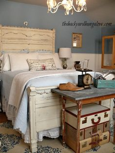 Mismatched furniture and salvaged pieces come together to create a cottage style bedroom.