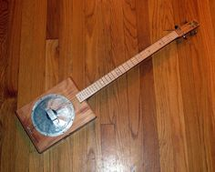 Handcrafted 4 string resonator cigar box guitar. $325.00, via Etsy.