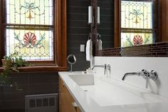 double fixture, single basin- creates two spots to wash up with but with a single drain!