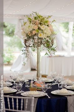 Candelabra centerpiece in a blush and white color palette!
