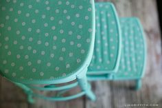 """Vintage Stool Updated """"I purchased one can of Liquitex in this pretty aqua color for this project. I found the perfect match in a polka dot oilcloth that I used to cover the steps and top of the stool. To attach the oilcloth to the metal I used high strength spray adhesive. """""""