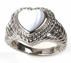 The ring's pure white stone and carved heart design is absolutely beautiful!