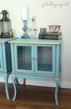 A pair of yard sale tables gets gilded with Annie Sloan Chalk Paint and Rustoleum metallic gold paint.  girlinthegarage.net