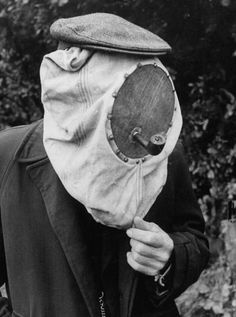 In this photo from 1956, Dutch beekeeper Gerrit Norssleman wears a hood w/ a small hole for a pipe... the smoke calmed the bees. (Photo: Thomas D. McAvoy—Time & Life Pictures/Getty Images)