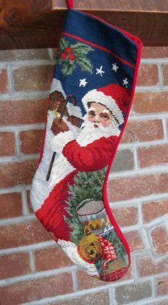 Wool Needlepoint Santa Christmas stocking, Christmas stocking, Velvet back, lined 21 inches. $22.00, via Etsy.