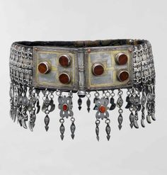 Central Asia or Iran | Belt; silver, fire gilded with applied and gallery wire, stamped bead and twisted wire decoration, table cut carnelians, and applique on leather. | 20th century
