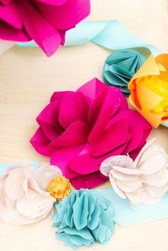 DIY paper flowers I feel school colors and some made from old books will make for lovely bouquets for my library:-)