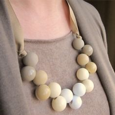 Use children's ponytail holder beads to create a chunky, ombre necklace.