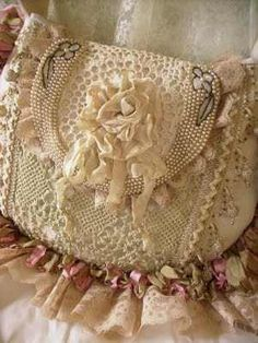 Clearly, I will need to make something like this.  I mean frilly, girly, antique look, crochet, ribbon and beads---has my name on it.  ...