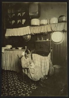 Little girl sewing to make money (New York, early 1900's)