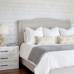 Love these bedding colors: White, grey, beige. Love the patterns in the accent pillows too.