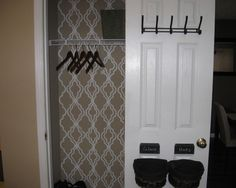 I love the wallpaper in this closet, but I especially like the baskets hung low on the door. My baskets on the shelves with gloves, scarves and hats always end up messy or dumped out!