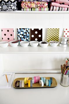 Lovely bowls and tray storage for tape and buttons. #storage #organization #organized #tape #buttons #fabric #shelves #white #tray