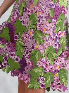Crochet skirt. Ireland lace. Lilac and green leaves  Colors of spring