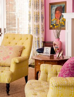love the pink walls and lemon chairs